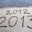 New Year 2013 replace 2012 concept on the sea beach — Stock Photo #22462321