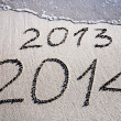 New Year 2014 replace 2013 concept on sebeach — Stock Photo #22462331