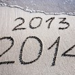 New Year 2014 replace 2013 concept on the sea beach — Stock Photo