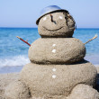 Snowman made out of sand. Holiday concept can be used for New Ye — Stock Photo