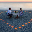 A young lovers couple share a romantic dinner with candles heart — Stock Photo #22462453