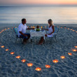 Royalty-Free Stock Photo: A young lovers couple share a romantic dinner with candles heart