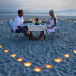 A young lovers couple share a romantic dinner with candles heart — Stock Photo #22462469