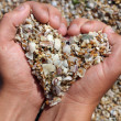 Hands holding a sand in form of the heart — ストック写真