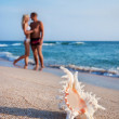 Loving couple hug one another on the sea sand beach against big — Stock Photo #22462841