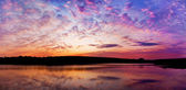 Panoramic sunset above the lake with bright colors go very well — Stock Photo
