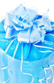 Festive packed blue nacreous present with big bow isolated on wh — Stock Photo