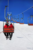 Skiers on a ski lift — Stockfoto