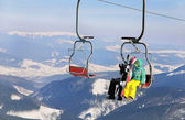 Snowboarders couple on a ski lift — Stock Photo