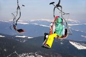 Skiers on a ski-lift — Stock Photo