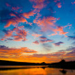 Sunset above the lake with bright colors — Stock Photo