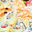 Appetizing tasty Japan rolls and sushi assortment — Stock Photo #24546325
