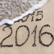 Happy New Year 2016 replace 2015 concept on sebeach — Stock Photo #24546415