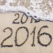 Happy New Year 2016 replace 2015 concept on the sea beach — Stock Photo