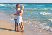 Loving couple walking on sea beach — Stock Photo