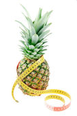 Pineapple and tape measure isolated on white background — Stock Photo