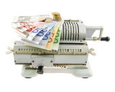 Vintage mechanical adding machine and money isolated on white — Stock Photo