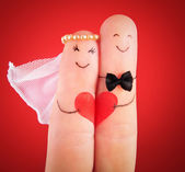 Wedding concept, newlyweds with heart against red background, p — Stock Photo