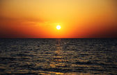 Bright sunset panorama under sea surface — Stock Photo