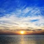 Bright paniramic sunset under the sea — Stock Photo #25795865