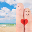Family vacation concept - a man and a woman drawn at fingers aga — Stock Photo #25796007