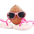 Coconut concept for travel with sunglasses and beach wear — Stock Photo