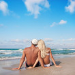 Young couple on the sea sand beach — Stock Photo