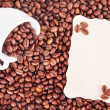 Coffee beans, white cup  and the paper sheet for notes — Стоковая фотография