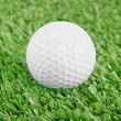 Golf ball on green golf field — Stock Photo