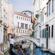 Venice canal with gondola, Italy — Stock Photo #25796621
