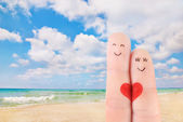 Family vacation concept - a man and a woman drawn at fingers aga — Stock Photo