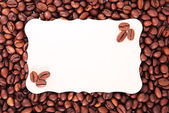 Coffee beans and the paper sheet for notes — Stock Photo