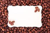 Grãos de café e a folha de papel para notas — Foto Stock