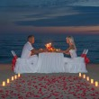 Young couple share a romantic dinner with candles — Stock Photo