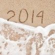Year 2014 wash away - beach concept for happy new year 2014 — Stock Photo
