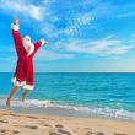 Santa Claus flying against sea beach - Christmas concept — Stock Photo