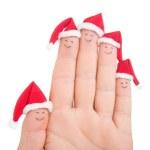 Fingers faces in Santa hats. Happy family celebrating concept fo — Stock Photo #36637481