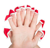 Fingers faces in Santa hats. Happy family celebrating concept fo — Stock Photo