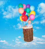 Child flying in sky — Photo