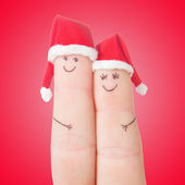 Fingers faces in Santa hats. Happy couple celebrating concept fo — Stock Photo