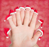 Fingers faces in Santa hats. Happy family celebrating concept fo — Stock Photo