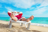 Sunbathing Santa Claus — Stock Photo