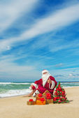 Santa Claus at sea beach — Stock Photo