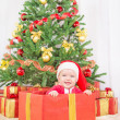 Happy child in christmas hat — Stock Photo