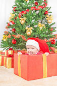 Happy child in christmas hat — Stock fotografie