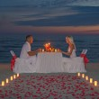 Couple during romantic dinner with candles — Stock Photo