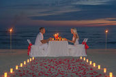 Couple during romantic dinner with candles — ストック写真