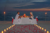 Couple during romantic dinner with candles — Stock fotografie