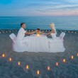 Couple at beach romantic dinner with candles heart — Stock Photo #45402515