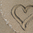 Heart drawn at sand. Sea beach background — Stock Photo #45402087